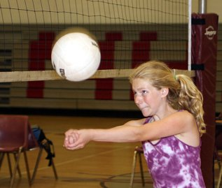 Ruthie Costanzo, 12, bumps the ball at the Parks and Recreation Department sponsored volleyball camp at Naugatuck High School July 14.