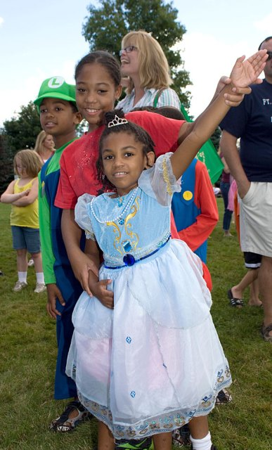 Evelin Lily Meade, 5, and Annika Mitchell, 8, wait in line for ice cream during character day at End of Summer Fun Week on the Prospect Town Green Aug. 22. The day featured face painting, train rides, and ice cream.