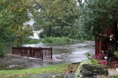 Water rushes over a bridge just over the Prospect town line in Cheshire Sunday. - LARAINE WESCHLER