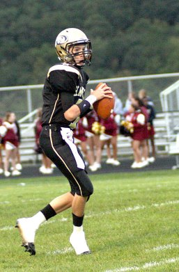 Woodland sophomore quarterback Tanner Kingsley, shown here in the Hawks' 41-18 win over Sacred Heart on Sept. 15, is the last in the Kingsley family.