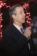 Patrick Charmel, President and CEO of Griffin Hospital speaks Monday night on the Town Green during a ceremony to kick off The Valley Goes Pink month.