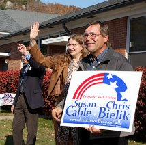 Carolyn McMahon, left, and Paul Yablonski, right, support Susan Cable and Chris Bielik outside Laurel Ledge Elementary school Tuesday. McMahon, a Democrat, lost her bid for a seat on the Board of Assessment Appeals to Republican Kathy Brown.