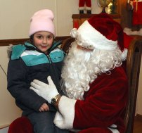 Children had a chance to share their Christmas wish list with Santa, meet Frosty, and watch Christmas movies with Rudolf and one of Santa's elves all at the Naugatuck Parks and Recreation's annual Santa's Village this week. Children toured the festive display with rooms filled with Christmas decorations from a miniature village to mechanical figures and a model train. Santa's Village will remain open from 5:30 p.m. to 7:30 p.m. through Dec. 23 at the Parks and Recreation office on Rubber Avenue. Admission is a non-perishable food item for the food bank. Photos with Santa are available for $5 or parents can bring their own cameras. The Park Department will also serve free hot chocolate, coffee, juice, and cider. Donations are welcome.