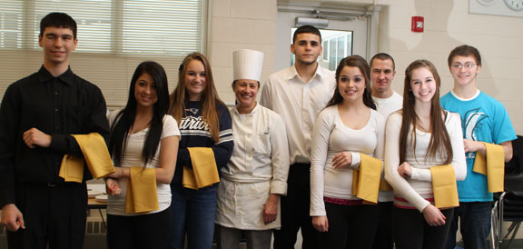 Culinary teacher Catherine Mirabilio, in hat, and her classes prepared hors d'oeuvres for parents and teachers for an event Monday morning. - LARAINE WESCHLER