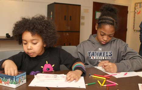 Runiyah Albino-Weathersby, 5, left, and Annika Mitchell, 9, work on Valentine's Day cards at the Prospect Public Library Feb. 10.