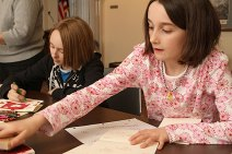 Jessica Przybylski, 12, left and Elayna Beutel, 8, create Valentine's Day cards at the Prospect Public Library Feb. 10.