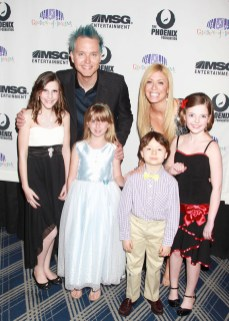 Prospect teenager Alyssa Casson, 13, in white and black dress, poses for a photo with Garden of Dreams Talent Show hosts Mark Hoppus and Jill Martin and fellow performers April 5. –DAVE ALLOCCA/STARPIX