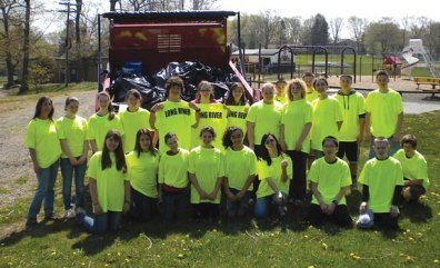 Members of the Long River School National Junior Honor Society participate in a town clean-up April 21 in Prospect. The clean-up was organized by Mayor Robert Chatfield and honor society advisor Sandra Pantaleo. Twenty four members of the society cleaned up along the streets of Prospect. After collecting a truckload full of trash, the students enjoyed lunch at the Dairy Bar in Prospect. –CONTRIBUTED