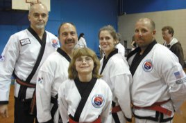 Four members of USA Martial Arts in Naugatuck were promoted at a Cheezic Tang Soo Do Black Belt karate graduation April 27 at the Boys Club in Waterbury. Pictured, from left, instructor Doug Wilke, Pete Meleschnig, promoted to 2nd Dan Black, Erin Reilly, Jessica Gallagher, and Anthony Oliver, who were all promoted to 1st Dan Black. – Photo contributed
