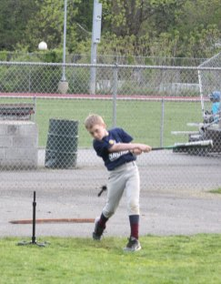 Kevin Klimaszewski, 9, of Naugatuck keeps his eye on the ball after knocking one off the tee during Major League Baseball's Pitch, Hit & Run competition May 5 at Naugatuck High School. The borough hosted the competition for the fourth year. Youth from Naugatuck and surrounding communities competed in pitching, hitting, and running contests for the opportunity to move on to the sectional round. – Photo by Elio Gugliotti