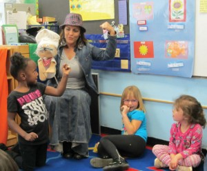 Family advocate Fatima Garcia helps Chef Combo teach Head Start and special education preschoolers in Naugatuck that healthy food creates strong muscles last year. The borough's Head Start program is facing about $33,000 in cuts due to the federal sequester. –RA ARCHIVE