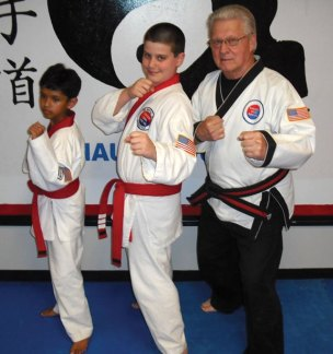 USA Martial Arts in Naugatuck held gradings for 38 junior members May 31. Abhishek Singh and Noah Santora, pictured with Grand Master Robert Cheezic, were promoted to apprentice Black Belt in Cheezic Tang Soo Do Karate.