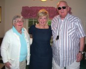 Helen and Ron Miller of Naugatuck pose for a picture with Republican U.S Senate candidate Linda McMahon during a recent social hosted by Linda and Tom Galvin of Prospect.