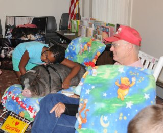 Farmer Paul Minor of Bristol his potbellied pig Daisy 2, and dog, Lily Pug, presented the Pig Out on Reading program at the Prospect Public Library July 20. –LUKE MARSHALL