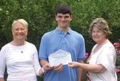 Cheshire Garden Club President Sue D'Agostino, of Prospect (right) and Scholarship Chair Ann O'Hara present Cheshire High School graduate Brian Sokoloff with a $1,000 scholarship award. The award is available to applicants pursuing the study of conservation, the environment, plant sciences or related fields. Sokoloff will be pursuing a bachelor's degree in environmental engineering at Worcester Polytechnic Institute. –CONTRIBUTED