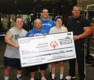 Waterbury resident and Naugatuck police Officer Derek Poundstone, right, presents Special Olympians, from left, Mike LoVetro, Dave Bouffard, Dave Hager and Phyllis Dilger with a donation of $1,460 recently at the Poundstone Performance Training Center in Waterbury. The donation, made to the Special Olympics Connecticut Northwest Region, was from the proceeds of the Bros vs. Pros event held at the training center in July. Poundstone deadlifted 850 pounds to win that event. Vasi's Restaurant also donated proceeds from food sales at the Bros vs. Pros event. –CONTRIBUTED