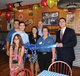 Dickey's Barbeque in Naugatuck celebrated its grand opening Aug. 24 with a ribbon cutting. Owners Mark, back left, and Donna Ferrari, center, took a moment away from the restaurant's busy atmosphere to celebrate along with family members Alexis Ferrari and Ryan Ferrari, state representatives David Labriola and Rosa Rebimbas and Naugatuck Mayor Robert Mezzo, far right.-LUKE MARSHALL