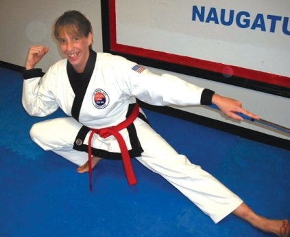 Naugatuck resident Liz Recce, a member of USA Martial Arts in Naugatuck, was invited to grade to 1st Dan Black Belt on Nov. 30 at the Boys Club in Waterbury. Reece completed all the forms, kicking, sparring, one-step, board breaking, four-man attack sequence and Asian weapons expertise requirements for the rank.-CONTRIBUTED