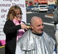 Naugatuck Big Y store director Jim Martin has his head shaved by head cashier Karen Sabia on Saturday. Martin and customer service manager Dave Mals shaved their heads to reward the store's staff for raising the most money in the district selling pink ribbons for the St. Mary's Breast Oncology Center. The store raised $3,618. –LUKE MARSHALL