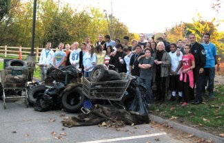 Three dozen Naugatuck High School Air Force Junior ROTC cadets recently cleaned the east riverbank of the Naugatuck River in Linden Park in Naugatuck led by Master Sgt. Gary Morrone, USAF (ret) and Lt. Col. Valerie Lofland, USAF (ret). This the sixth time this group has completed conservation projects along the Naugatuck River. More than a dozen bags of light debris, several shopping carts and tires, a rug, pieces of board and rusted metal debris were removed. The project was organized by Joe Savarese and Bob Gregorski of the Naugatuck River Watershed Association and sponsored by the borough of Naugatuck including the Mayor's office, public works and recreation departments. Ron Tymula Manager of Student Transportation of America in Naugatuck donated the bus transportation. -CONTRIBUTED