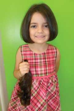Juliana Felix, 5, of Naugatuck donated her hair to Locks of Love Oct. 13. When asked why, Felix said she donated her hair to the sick children that have no hair. -CONTRIBUTED