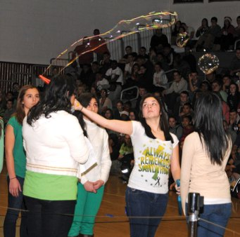 Naugatuck High School paid tribute to the victims of the Sandy Hook Elementary School shooting Dec. 21. Twenty-six students lined the middle of the gym and created a bubble in honor of each of the 26 victims as their names were read. The tribute included the poem, 'The Field Trip,' read by sophomore Lacie Dube and 'Danny Boy' sung by junior Jussonjah Duby accompanied by junior Megan McSweeny on the flute. –LUKE MARSHALL