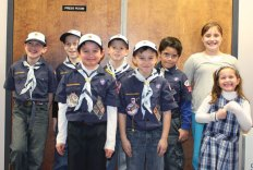 Cub Scouts from Den 5 of Naugatuck's Pack 115 visited the Citizen's News office in Naugatuck Dec. 14 to learn about journalism and newspapers for a badge.-ELIO GUGLIOTTI