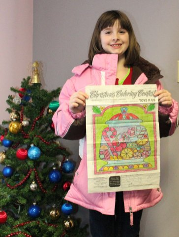 Kimberly Poulos, of Beacon Falls, won the Citizen's News Christmas coloring contest in the 6- to 8-year-old age group.-ELIO GUGLIOTTI