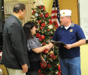 Beacon Falls First Selectman Gerard Smith, left, and Beacon Falls' American Legion Schaeffer-Fischer Post 25 Commander Bruce Carlson present a plaque to Ansonia Steel Fabricators owner Deb Hogestyn Dec. 20 for her company's assistance in helping the town put the flags up on the streetscape. According to American Legion Post 25 Adjunct Richard Minnick, the flags and holders were two different sizes, which meant the town would not be able to have the flags flying during the opening ceremony of the streetscape in the fall. However, Ansonia Steel was able to make the flag holders the correct size and ensure the flags were hung by the opening ceremony.-LUKE MARSHALL