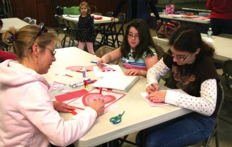 Salem Lutheran Church members Carolyn Burger and her daughters Londyn and Lauren, from Naugatuck make Valentine cards during the Trumbull-Porter Chapter DAR's 6th Annual Valentine Workshop at Salem Lutheran Church in Naugatuck Jan. 19. Over 155 Valentine cards were made to be distributed to the veterans at the VA Hospitals in West Haven, Rocky Hill and Connecticut Valley as part of the National Society Daughters of the American Revolution (NSDAR) Salute to Hospitalized Veterans. More than 20 DAR members and grandchildren, members of The Charles Merriman Society Children of the American Revolution and members of Salem Lutheran Church participated in the workshop. –CONTRIBUTED