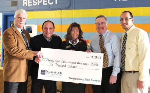 The Naugatuck Savings Bank Foundation recently awarded a $10,000 grant to the Boys & Girls Club of Greater Waterbury to support its Triple Play Program, a program that encourages healthy lifestyles for children. Pictured, from left, Boys and Girls Club of Greater Waterbury Executive Director John Chiero, Boys and Girls Club of Greater Waterbury Board of Directors member Frank Longo, Naugatuck Savings Bank Branch Manager Teresa Carrier, Boys and Girls Club of Greater Waterbury Chairman of the Board of Directors William Campion and Director of Operations for Boys and Girls Club of Greater Waterbury Manny Martinez. -CONTRIBUTED