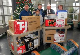 American Legion Post 17 of Naugatuck presented 19 boxes of supplies to be distributed to hospitalized vets at the VA Hospital in West Haven on Jan 19. These supplies were collected at a fundraiser held at the Naugatuck Stop & Shop and included toiletries, personal hygiene products, stationery and writing implements and books. Pictured, from left, Senior Vice Commander Ron Fischer, Assistant Service Officer Nick Aprea, Commander Tom Honyotski, American Legion Department of Connecticut Commander Wayne Morgan and American Legion Department of Connecticut Auxiliary Assistant Historian Ruth Morgan.
