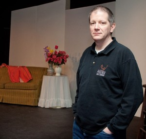 Ed Bassett, one of the partners in Phoenix Stage Company in Naugatuck, stands in front of the stage set on Thursday. –RA ARCHIVE