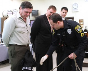 Canine Pete, a narcotics detecting black Labrador, is pictured above with handler Naugatuck police Officer Kevin Zainc demonstrating his ability to sniff out drugs at a Board of Education meeting in December 2011. Pete has retired after five years with the department. –FILE PHOTO
