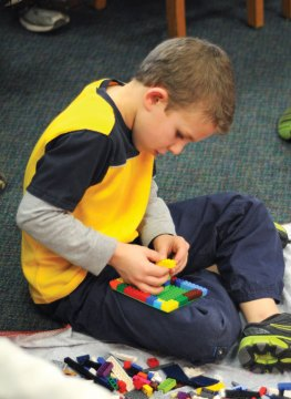 Preston Alessio, 7, from Beacon Falls plays with Legos during the Beacon Falls Public Library's Legos in the Library program Feb. 13. –LUKE MARSHALL