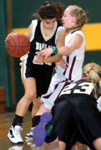 Alma Rizvani (20) of Woodland tries to drive through Paige Middelton (12) of Torrington during the Naugatuck Valley League tournament at Holy Cross High School in Waterbury Monday. The Hawks fell to the Red Raiders, 61-39. –RA ARCHIVE