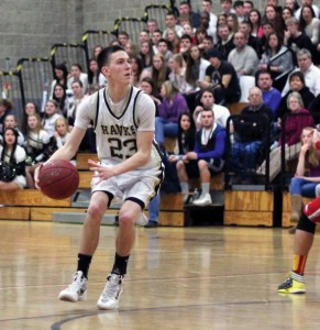 Woodland's Tanner Kingsley (23) eyes the basket before lining up and draining a shot last Friday night in Beacon Falls. Kingsley hit nine 3s on his way to a career-high 42 points, both school records, as the Hawks soared past the Eagles, 86-73. –ELIO GUGLIOTTI