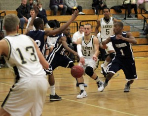 Woodland's David Uhl (21) has grown into a confident leader for the Hawks and is averaging 16.9 points per game this season, good for 11th-best in the NVL. –FILE PHOTO