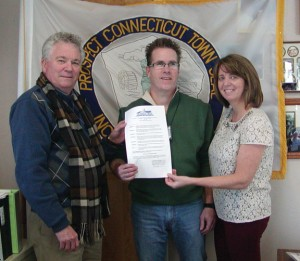 Prospect Mayor Robert Chatfield, left, presents a proclamation last year to Prospect residents Michael and Robin Tuohy, proclaiming March 2013 as Myeloma Awareness Month in Prospect. The Touhys are working to spread awareness on myeloma -CONTRIBUTED