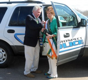 Prospect Mayor Robert Chatfield, left, places a sash on Carole Dwyer Moschella March 14 in front of Town Hall. Moschella was honored as the town's Irish Mayor for the Day. –LUKE MARSHALL