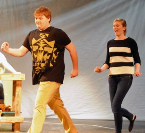 Woodland Regional High school Senior Eric Gomez, left, and junior Karlee Vogel rehearse a scene from Woodland Theatre's production of 'Little Shop of Horrors' last week at the school in Beacon Falls. Gomez is playing the part of Seymour, and Vogel is playing the role of Audrey. The theatre will present the play April 5 and April 6. –LUKE MARSHALL