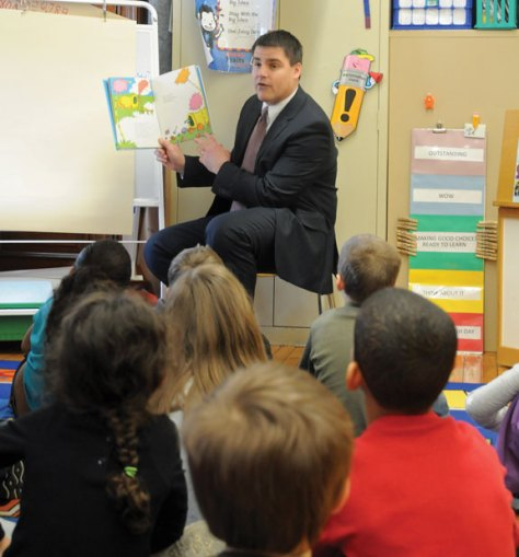 Local schools celebrated Read Across America March 1 in honor of Dr. Seuss' birthday, which was March 2, with guest readers, dressing up and reading their favorite books. Naugatuck Mayor Robert Mezzo reads to second-grade students at Salem Elementary School. –LUKE MARSHALL