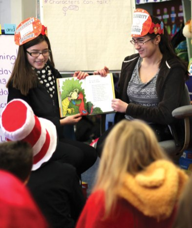 Local schools celebrated Read Across America March 1 in honor of Dr. Seuss' birthday, which was March 2, with guest readers, dressing up and reading their favorite books. Eighth-graders from Long River Middle School Melanie Vieira, left, and Olivia Rua read to students in Jill Medina's kindergarten class at Algonquin School in Prospect. –ELIO GUGLIOTTI