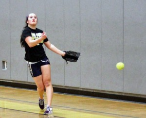 Woodland junior Samantha Lee practices March 22 at the school in Beacon Falls. Lee, the Hawks' starting pitcher, will return to circle this season healthy after missing portions of the past two years due to injuries. –ELIO GUGLIOTTI