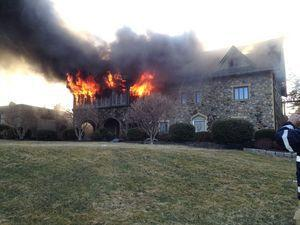 A fire burns at the estate of designer Louis Nichole April 5 on New Haven Road in Prospect. –CONTRIBUTED