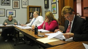 Naugatuck Board of Education member Dorothy Neth-Kuninm, left, Assistant Business Manager Robert Butler, Assistant Superintendent of Schools Brigitte Crispino and Superintendent of Schools John Tindall-Gibson look over the board's proposed 2013-14 budget Monday night. The proposal is roughly $59.69 million, an increase of $1.6 million or 2.77 percent, ad will be presented to the boards of Finance and Mayor and Burgesses at a budget hearing April 8. –LUKE MARSHALL