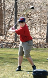 Naugatuck High School junior Brendan Waldron tees off April 9 during a scrimmage against Holy Cross at Hop Brook Golf Course in Naugatuck. –LUKE MARSHALL