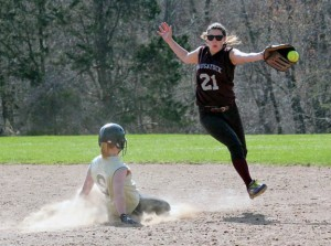 Woodland's Cameron Caswell (9) steals second as Sarah Chandler (21) of Naugatuck leaps to try to snag the throw Monday afternoon in Beacon Falls. The Hawks rallied to win the game, 5-4, in eight innings. –ELIO GUGLIOTTI