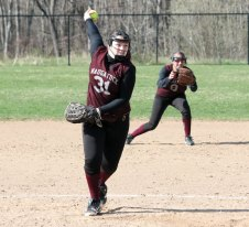 Naugatuck's Nina Kosciuszek (31) winds up for a pitch as Erica Andreoli (9) digs in at second base Monday versus Woodland in Beacon Falls. The Hawks rallied to win the game, 5-4, in eight innings. –ELIO GUGLIOTTI