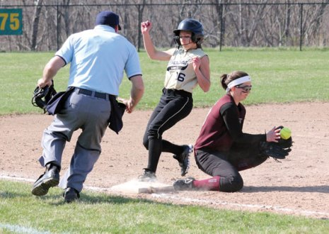 Woodland's Natalie Veneri (16) is safe at third as Naugatuck outfielder Gretchen Hale covers the base Monday afternoon in Beacon Falls. The Hawks rallied to win the game, 5-4, in eight innings. –ELIO GUGLIOTTI